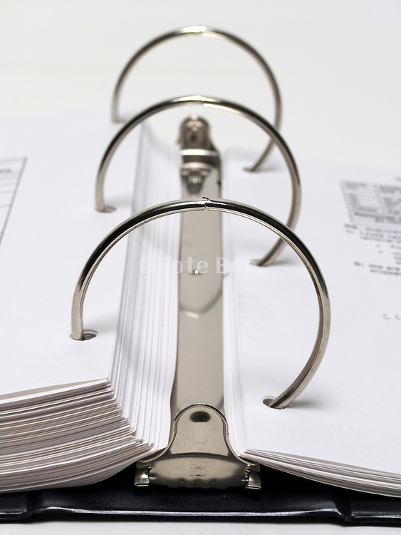 close up of filing folder full of papers