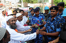 June 26, 2017 - Allahabad, India - Muslims offer roses to RAF workers on the occasion of Eid-Ul-Fitr. (Credit Image: © Prabhat Kumar Verma/Pacific Press via ZUMA Wire)