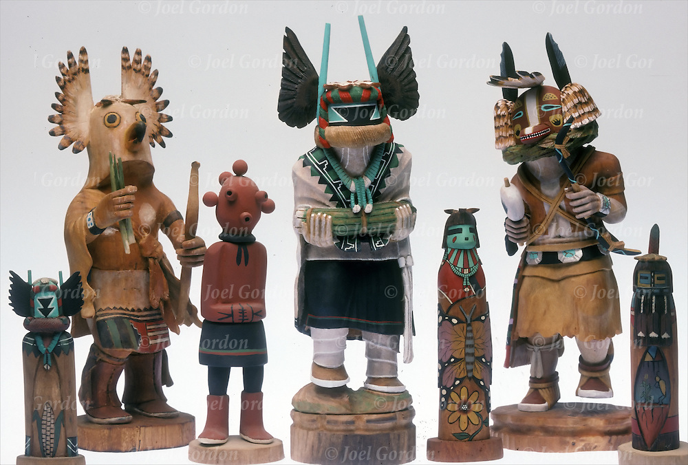 Studio photography of Hopi Native American Kachinas Dolls, hand painted sculptures,carvings from the cottonwood..Within Hopi mythology, the Kachinas are said to live on the San Francisco Peaks near Flagstaff, Arizona. The most important Hopi Kachinas are called wuya...Among the Hopi, Kachina dolls are traditionally carved by the uncles and given to uninitiated girls at the Bean Dance (Spring Bean Planting Ceremony) and Home Dance Ceremony in the summer. The function of the dolls is to acquaint children with some of the many Kachinas...In Hopi the word is often used to represent the spiritual beings themselves, the dolls, and the people who dress as Kachinas for ceremonial dances, which are understood to all embody aspects of the same belief system. Among other uses, the Kachinas represent historical events and things in nature, and are used to educate children in the ways of life.