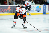 KELOWNA, CANADA, OCTOBER 11:  Alex Theriau #23 of the Medicine Hat Tigers take a shot on net during warm-up as the Medicine Hat Tigers visited the Kelowna Rockets on October 11, 2011 at Prospera Place in Kelowna, British Columbia, Canada (Photo by Marissa Baecker/shootthebreeze.ca) *** Local Caption ***Alex Theriau;
