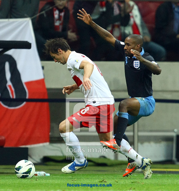 Picture by Paul Chesterton/Focus Images Ltd +44 7904 640267.17/10/2012.Grzegorz Krychowiak of Poland and Jermain Defoe of England in action during the 2014 FIFA World Cup Qualifying match at the National Stadium, Warsaw.