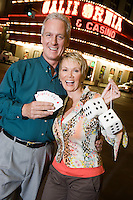 Middle-aged couple in front of casino building, portrait