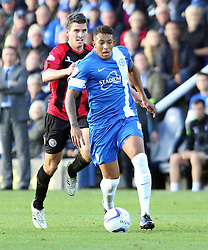 Peterborough United's Nathaniel Mendez-Laing in action with Shrewsbury Town's David McAllister - Photo mandatory by-line: Joe Dent/JMP - Tel: Mobile: 07966 386802 19/10/2013 - SPORT - FOOTBALL - London Road Stadium - Peterborough - Peterborough United V Shrewsbury Town - Sky Bet League One