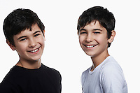 Twin boys (13-15) smiling portrait