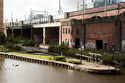 looking across Manchester Bridgewater Canal towards the Metro Link close to  the bridge that carries Mancunian Way and Egrton Street..29  September 2012.Image © Paul David Drabble