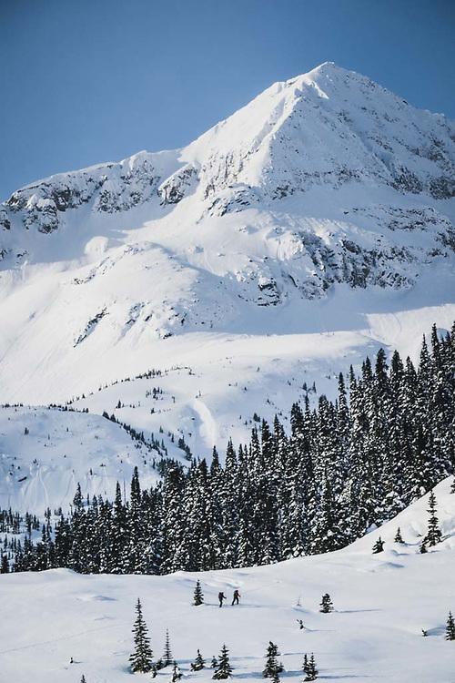 A grou skins benath Lakehead Peak, Howson Range, British Columbia.