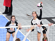 Mount Vernon's Ali Stark (20) goes for a kill during the fourth game of a 3A semifinal in the state volleyball tournament at the U.S. Cellular Center at 370 1st Ave E on Friday afternoon, November 12, 2010. (Stephen Mally/Freelance)