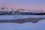 Sunset alpenglow over the Chugach Mountains and the Knik River in Southcentral Alaska. Winter. Afternoon.