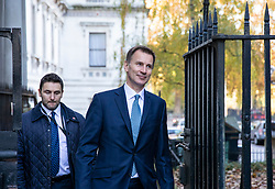 © Licensed to London News Pictures. 13/11/2018. London, UK. Foreign Secretary Jeremy Hunt (R) arrives on Downing Street for the Cabinet meeting. Photo credit: Rob Pinney/LNP