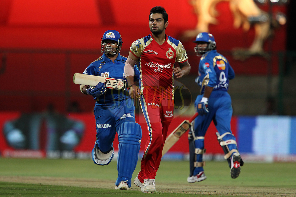 Virat Kohli, Sachin Tendullkar and Ambati Rayudu during match 8 of the the Indian Premier League ( IPL ) Season 4 between the Royal Challengers Bangalore and the Mumbai Indians held at the Chinnaswamy Stadium, Bangalore, Karnataka, India on the 12th April 2011..Photo by Ron Gaunt/BCCI/SPORTZPICS