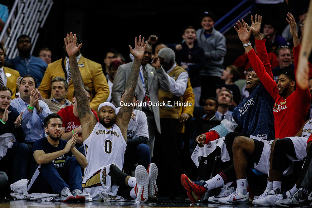 Mar 14, 2017; New Orleans, LA, USA; New Orleans Pelicans forward DeMarcus Cousins (0) celebrates along with forward Dante Cunningham and forward Anthony Davis during the final seconds of the fourth quarter of a game against the Portland Trail Blazers at the Smoothie King Center. The Pelicans defeated the Trail Blazers 100-77. Mandatory Credit: Derick E. Hingle-USA TODAY Sports