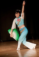 Foreign exchange student Omica Xiao performs a classical Chinese dance during the LHS Talent Show Wednesday evening.  Omica tied for third place along with Susannah O'Brien and Beth Kneur for their singing talents.  (Karen Bobotas/for the Laconia Daily Sun)
