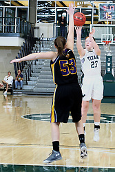 12 December 2015:  Maddie Merritt shoots a three pointer over Allie Miceli during an NCAA women's basketball game between the Wisconsin Stevens Point Pointers and the Illinois Wesleyan Titans in Shirk Center, Bloomington IL