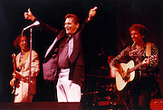 """Rockabilly Sun Studio veteran Billy Lee Riley (center) was in vited by Bob Dylan (right) to perform in Dylan's concert in Little Rock in September 1992. Dylan introduced Riley as """"my hero."""" (By Karen Pulfer Focht / The Commercial Appeal) ran 9/20/92)"""