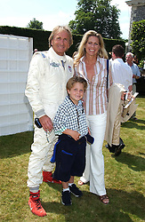 """DEREK & MISTI BELL with their son SEBASTIAN at a luncheon hosted by Cartier at the 2005 Goodwood Festival of Speed on 26th June 2005.  Cartier sponsored the """"Style Et Luxe' for vintage cars on the final day of this annual event at Goodwood House, West Sussex. <br /><br />NON EXCLUSIVE - WORLD RIGHTS"""