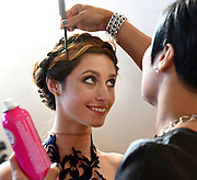 Photo by Mara Lavitt -- Special to the Hartford Courant<br /> October 4, 2015 <br /> Hartford Fashion Week, last day, Union Station, Hartford. Six designers showed their fashions. Saints by S.J. model Maddy Wooding of Middlefield's hair gets a primp by stylist Elieza Cicero of Newington and the International Institute of Cosmetology.
