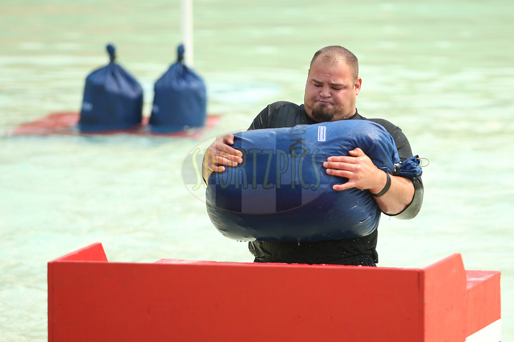 Brian Shaw (USA) places the heavy weight on the platform in the sand sack race in the pool at the Valley of the Waves during the final rounds of the World's Strongest Man competition held in Sun City, South Africa.