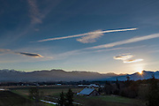 Winter sunset over the Olympic mountains and Sequim Valley, with the Lotzgezell barn.