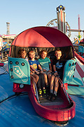 Kids having fun on the Tilt-a-whirl at the Twin Falls County Fair, Twin Falls, Idaho.