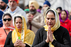 © Licensed to London News Pictures. 10/04/2016. London, UK. People pray ahead of the festivities at Vaisakhi, the Sikh New Year and harvest festival, in Southall, west London, where crowds of thousands attend annually. Photo credit : Stephen Chung/LNP