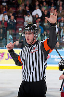 KELOWNA, CANADA - OCTOBER 4:  Brett Iverson, referee makes a call against the Portland Winterhawks  at the Kelowna Rockets on October 4, 2013 at Prospera Place in Kelowna, British Columbia, Canada (Photo by Marissa Baecker/Shoot the Breeze) *** Local Caption ***