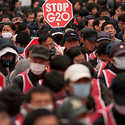 Protestors hold signs and shout slogans during an anti-G20 protest in Seoul, South Korea, November 11, 2010.