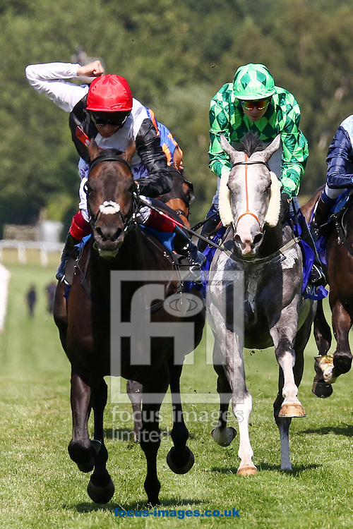 Frankie Dettori riding Derby winner Golden Horn (Black/White, Red) wins the Group One Coral-Eclipse feature race during the Coral-Eclipse Day at Sandown Park, Esher<br /> Picture by Mark Chappell/Focus Images Ltd +44 77927 63340<br /> 04/07/2015