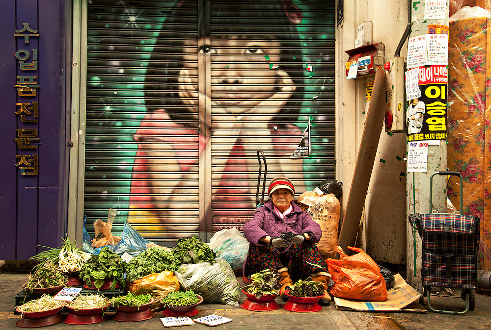 A vendor selling fresh produce at Gupo Market, Busan, South Korea, December 10, 2013.