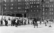 Game of badminton on the ice skating rink at the Chateau Frontenac, photograph, 1960s, from the Archives of the Chateau Frontenac, Quebec City, Quebec, Canada. The Chateau Frontenac opened in 1893 and was designed by Bruce Price as a chateau style hotel for the Canadian Pacific Railway company or CPR. It was extended in 1924 by William Sutherland Maxwell. The building is now a hotel, the Fairmont Le Chateau Frontenac, and is listed as a National Historic Site of Canada. The Historic District of Old Quebec is listed as a UNESCO World Heritage Site. Copyright Archives Chateau Frontenac / Manuel Cohen