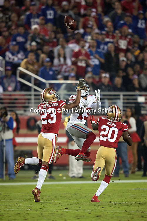 San Francisco 49ers cornerback Ahkello Witherspoon (23) and San Francisco 49ers cornerback Jimmie Ward (20) break up a deep pass intended for leaping New York Giants wide receiver Odell Beckham Jr. (13) in the fourth quarter during the NFL week 10 regular season football game against the San Francisco 49ers on Monday, Nov. 12, 2018 in Santa Clara, Calif. The Giants won the game 27-23. (©Paul Anthony Spinelli)