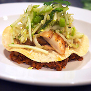 fish tostada with apple slaw and lentils