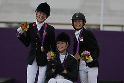 Christiansen, Sophie;<br /> Tan, Laurentia;<br /> Kearney, Helen, <br /> London Paralympics 2012<br /> Siegerehrung Garde III + Garde 1a<br /> © www.sportfotos-lafrentz.de/ Stefan Lafrentz