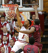 Indiana Hoosiers guard James Blackmon Jr. slams in two points over Greyhound Joe Lawson to give his team the lead for the first time in the first half. Indiana hosted the University of Indianapolis in a preseason game at Assembly Hall on Monday, November 10, 2014.