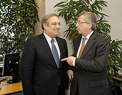 Jean-Claude Juncker, Luxembourg's prime minister, greets Ioannis Papathanasiou, Greece's finance minister, during a bilateral meeting at the European Council headquarters in Brussels, Belgium, on Monday, Jan. 19, 2008. (Photo / Jock Fistick).