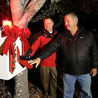 Adam Robison | BUY AT PHOTOS.DJOURNAL.COM<br /> Don Lewis, COO for the City of Tupelo, is assisted by Jerry Stubblefield, of Fulton, as they flip the switch to turn on the Christmas lights at Ballard PArk Thursday night. Stubblefield donated his Christmas light collection to the City of Tupelo this year and the lights are on display this season for area residents to enjoy.