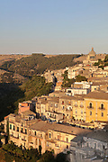 Hill town of Ragusa Ibla, in Sicily, Italy. The town is split into the lower and older town of Ragusa Ibla, and the higher upper town of Ragusa Superiore, separated by the Valle dei Ponti. It is built on the site of an ancient city, inhabited by Sicels, Greeks, Carthaginians, Romans, Byzantines, Arabs and Normans. In 1693 it was devastated by an earthquake, and was rebuilt in the Baroque style. The town forms part of the Late Baroque Towns of the Val di Noto UNESCO World Heritage Site. Picture by Manuel Cohen