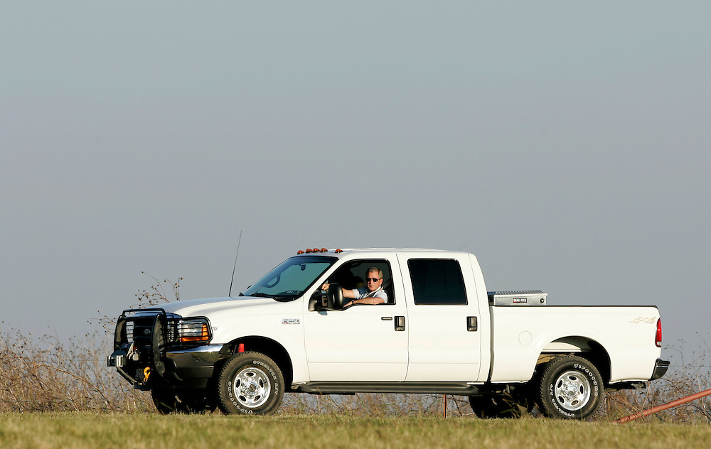 U.S. President George W. Bush and First Lady Laura Bush await the arrival of German Chancellor Angela Merkel and her husband Joachim Sauer at the Bush's ranch in Crawford Texas USA on 09 November 2007. Merkel and Bush are expected to discuss the situation in Iran during her visit.