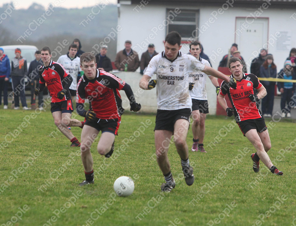 Clondegads Tony Kelly and Ennistymons Cathal Malone in action in the U21A Football Final in Corofin on Saturday.<br /> Pic. Brian Arthur/ Press 22.