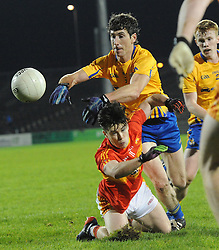Castlebar&rsquo;s Cian Costelle and Knockmore&rsquo;s Andrew Keane contest posession during the county senior football final at McHale park.<br /> Pic Conor McKeown