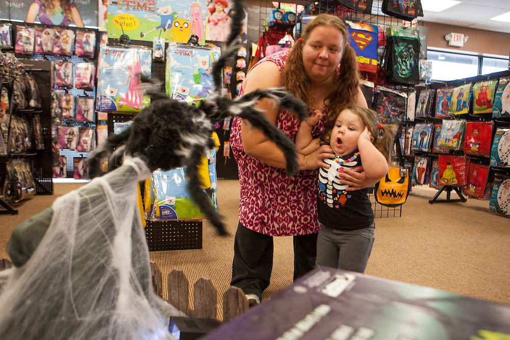 "Serenity leaps back when a giant spider darts out from a web in the ``Spirit of Halloween"" costume store in Dardenne Prairie, MO. Halloween is big holiday in the Jenkins house where all family members wear costumes."
