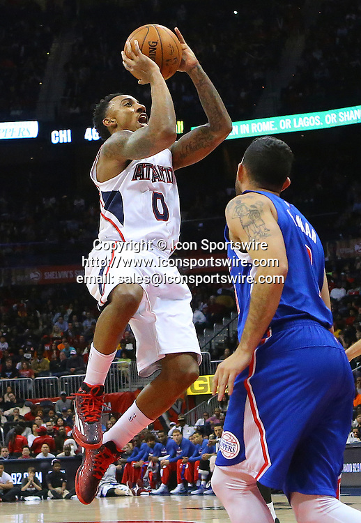 Dec. 23, 2014 - Atlanta, GA, USA - The Atlanta Hawks' Jeff Teague (0) shoots over the Los Angeles Clippers' DeAndre Jordan at Philips Arena in Atlanta on Monday, Dec. 23, 2014