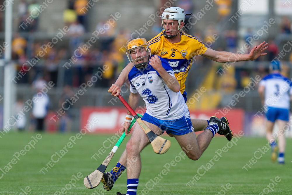 Clare's Conor Cleary persues Waterford's Ryan Donnelly