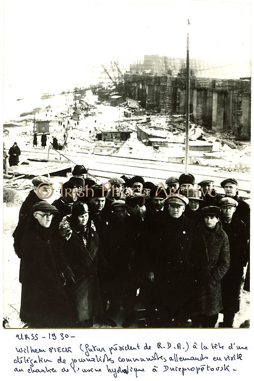 USSR 1930. Wilhelm Pieck (1876-1960), German communist statesman and President of the German Democratic Republic (1949-1960), leading a delegation of German communist journalists to view the construction of the hydroelectric plant at Dniepropetovsk.
