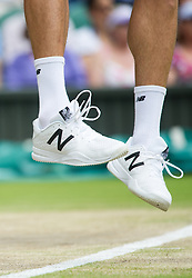 LONDON, ENGLAND - Friday, July 8, 2016:  Close up of Milos Raonic (CAN) feet whilst serving wearing with his North Balance shoes and socks during the Gentlemen's Singles - Semi-finals match on day twelve of the Wimbledon Lawn Tennis Championships at the All England Lawn Tennis and Croquet Club. (Pic by Kirsten Holst/Propaganda)