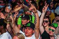 Man smoking his bong in the crowd at the 420 Cannabis Culture Music Festival, Civic Center Park, Downtown Denver, Colorado USA. This was the first 4/20 celebration since recreational pot became legal in Colorado January 1, 2014. A crowd of up to 80,000 people attended the event.