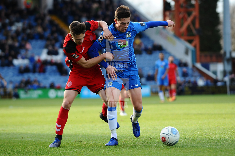 TELFORD COPYRIGHT MIKE SHERIDAN 16/2/2019 - Ryan Bennett of AFC Telford battles for the ball with Scott Duxbury of Stockport during the Vanarama Conference North fixture between Stockport County and AFC Telford United at Edgeley Park