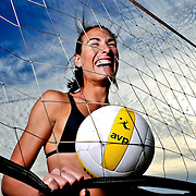 jduty_ssav_Thu_01 Angie Acers  enjoys a moment in the sand and sun,as she prepares for the start of beach vollyball season.