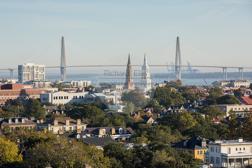 Aerial view of St Michaels and St Philips Churches with the Ravenel Bridge Charleston, South Carolina.