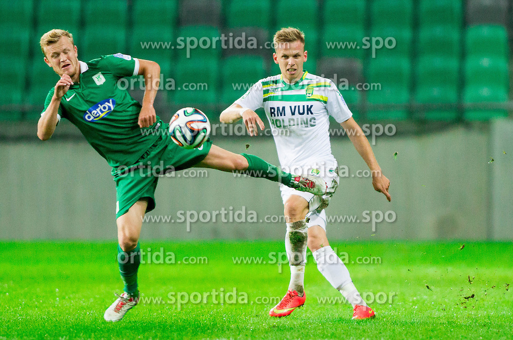 Nik Omladic #21 of Olimpija vs Andrej Dugolin of Zavrc during football match between NK Olimpija and NK Zavrc in 8th Round of Prva liga Telekom Slovenije 2014/15, on September 13, 2014 in SRC Stozice, Ljubljana, Slovenia. Photo by Vid Ponikvar  / Sportida.com