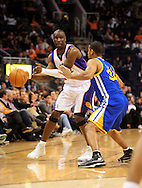 Feb. 10, 2011; Phoenix, AZ, USA; Phoenix Suns guard Mickael Pietrus (12) makes a pass against the Golden State Warriors guard Charlie Bell (34) at the US Airways Center.  The Suns defeated the Warriors 112 - 88.  Mandatory Credit: Jennifer Stewart-US PRESSWIRE..